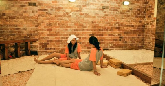 A couple of ladies chilling in the clay room at a Korean Spa
